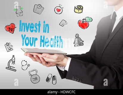 Invest in your health concept. Healty lifestyle background. Man holding a tablet computer. - Stock Photo