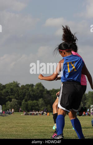 Two players in an Indiana summer league match between the girls' soccer teams of Blackhawk Christian & South Side - Stock Photo