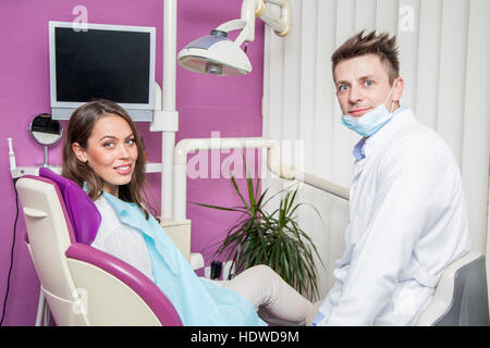 Young woman getting dental treatment in dentist office - Stock Photo