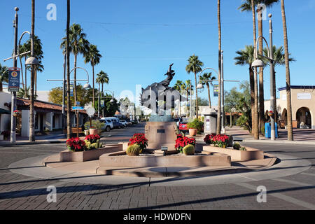 Jack Knife Sculpture on Main Street. By artist Ed Mell, the bronze statue, of a rider on a bucking horse was inspired - Stock Photo