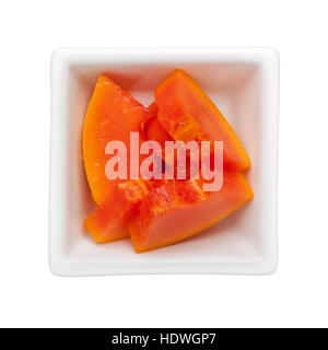 Slices of papaya in a square bowl isolated on white background - Stock Photo