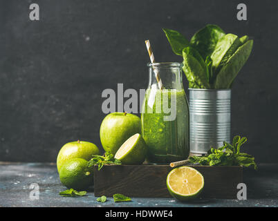 Green smoothie in bottle with fresh fruits, copy space - Stock Photo
