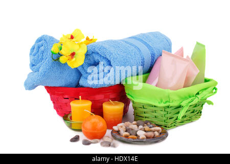 Spa set with towels, creams, lotions, candles, stones and flower isolated on white background. - Stock Photo