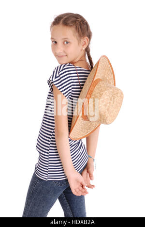 Pretty twelve year old girls wearing a big floppy straw sun hat isolated on white - Stock Photo
