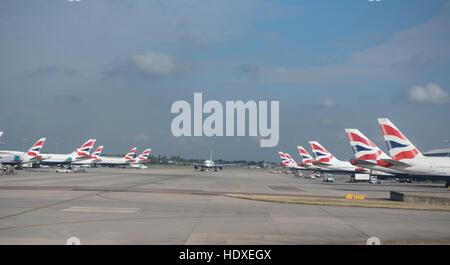 British Airways aircraft fleet parked outside terminal 2 at Heathrow Airport London UK  SCO 11,275. - Stock Photo