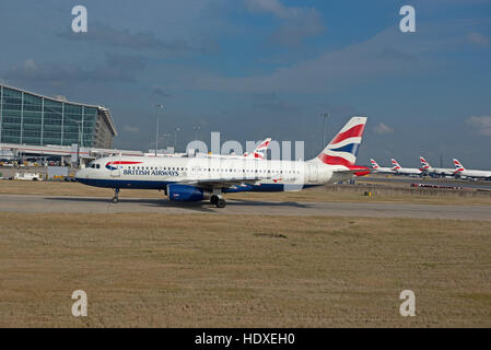British Airways aircraft parked outside terminal 2 at Heathrow Airport London UK  SCO 11,277. - Stock Photo