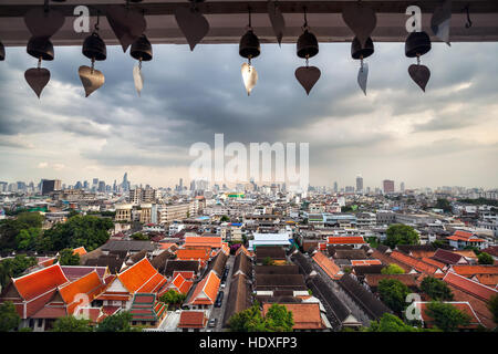 Bangkok city view of skyscrapers business district from Golden Mountain Pagoda Wat Saket at overcast sky background. - Stock Photo