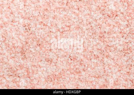 Edible Pink Himalayan rock salt background - Stock Photo