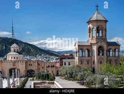 Georgia, Tbilisi , Avlabari district . Bell tower in the complex of the Holy Trinity Cathedral of Tbilisi . - Stock Photo