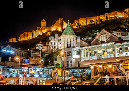 Georgia, Tbilisi night . View from Gorgasali square of the old town , the fortress Narikala , Cathedral of Surb - Stock Photo