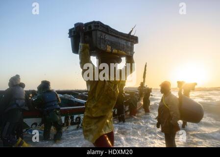 FIshermen, peddlers, boats in Nouakchott's famous fish market - Stock Photo