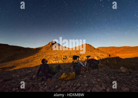 Cycling in the High Atlas, Morocco - Stock Photo