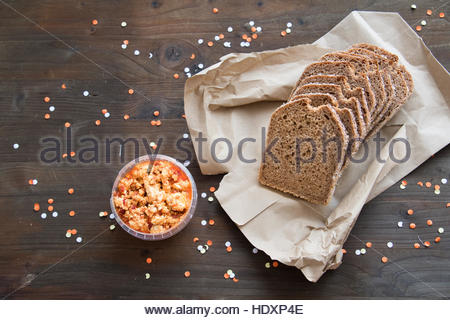Organic food brown bag bread sliced bread bread on table bread and cheese loaf bread close up slices Wholemeal Bread - Stock Photo