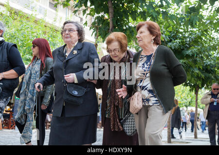 Three elderly women walking through the streets of the Plaka district in Athens - Stock Photo