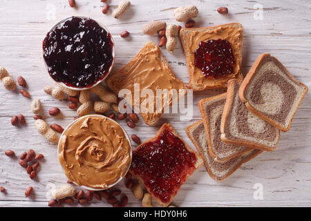 Sandwiches with peanut butter and jelly close-up on the table. horizontal view from above - Stock Photo