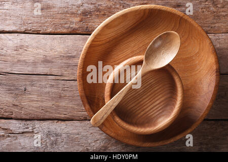 Wooden dish and spoon in a rustic style. horizontal view from above - Stock Photo