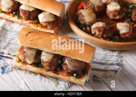 Hot sandwiches with meat balls, cheese and herbs close-up horizontal view from above - Stock Photo