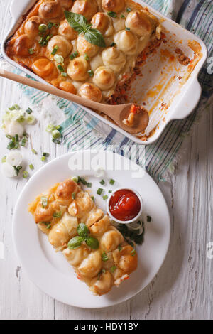serving of cottage pie closeup on a white plate. vertical top view - Stock Photo