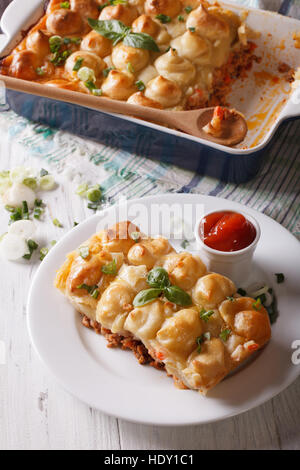 shepherds pie slice closeup on a white plate. Vertical - Stock Photo