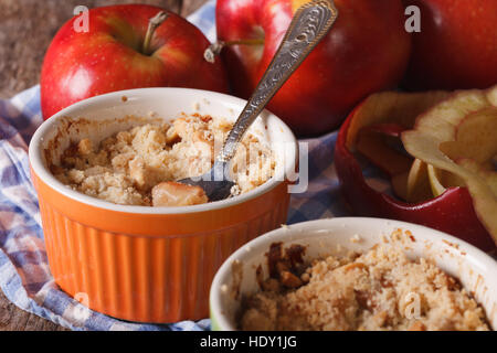 English crumble with apples close-up in the pot. Horizontal rustic style - Stock Photo