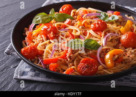 Italian food: pasta with minced meat and vegetables close-up. horizontal - Stock Photo