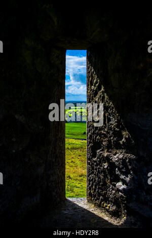 Window at Rock of Cashel with View to Castle and Landscape in Ireland - Stock Photo
