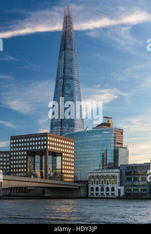 London's Shard photographed at sunset from the northside of the  river Thames and showing London Bridge - Stock Photo