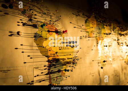 Photo of the pins attached to the map of the world - Stock Photo