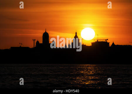The Silhouette of the Cathedral of Helsinki and its nearby houses - Stock Photo