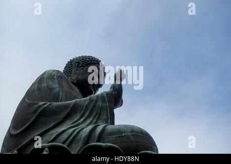 Tian Tan Buddha (Great Buddha) is a 34 meter Buddha statue located on Lantau Island in Hong Kong. - Stock Photo