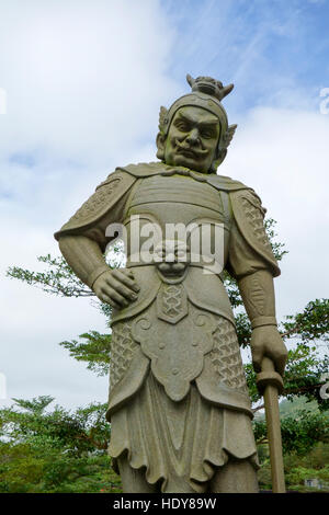 Statue on walkway to Tian Tin monastery and the Big Buddha at Ngong Ping village on Lantau Island, Hong Kong. - Stock Photo