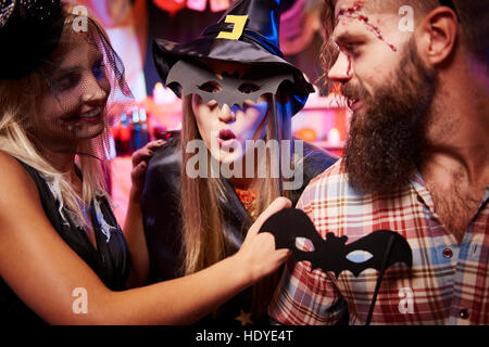 Woman scaring with a bat mask - Stock Photo