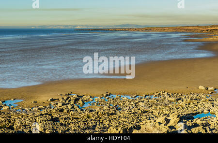 Rest Bay, a popular beach near Porthcawl in south Wales, photographed on a clear winter day - Stock Photo