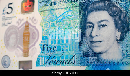 The new five pound note, new fiver, is seen in a photograph posed in a studio in London, Britain December 12, 2016. - Stock Photo