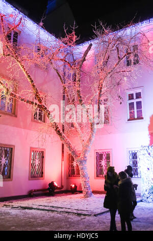 People sightseeing the ornate Art gallery Klovicevi Dvori in the Gradec, upper old town, Zagreb, Croatia. - Stock Photo