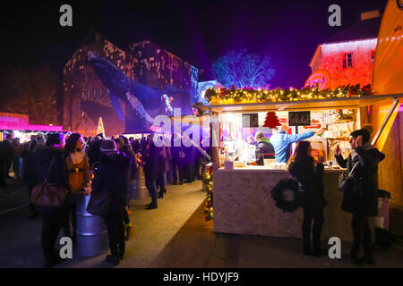 People drinking and eating food from food stands in front of the Art gallery Klovicevi Dvori in the upper old town,Gradec,Zagreb - Stock Photo
