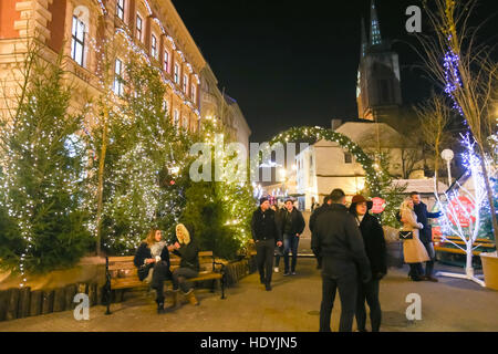 ZAGREB, CROATIA - DECEMBER 1th, 2016: Advent time in city center of Zagreb, Croatia. People sightseeing ornated - Stock Photo