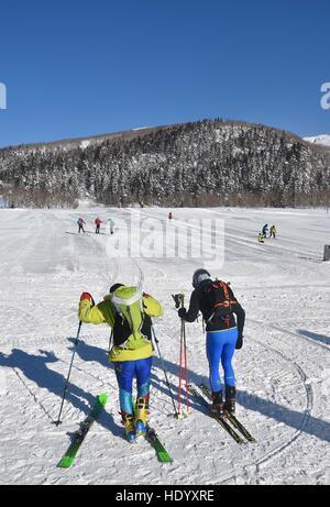 Changchun, China's Jilin Province. 15th Dec, 2016. Tourists ski around the Tianchi Lake on the Changbai Mountain, - Stock Photo