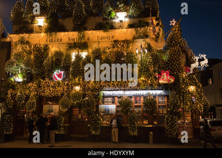 London, UK. 14th December, 2016. Festive Christmas atmosphere at The Churchill Arms pub in Kensington covered by - Stock Photo