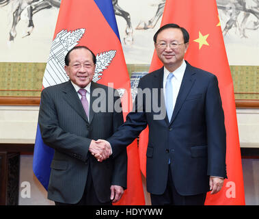 Beijing, China. 15th Dec, 2016. Chinese State Councilor Yang Jiechi (R) meets with Cambodian Deputy Prime Minister - Stock Photo