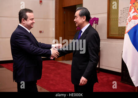 Beijing, China. 15th Dec, 2016. Chinese Foreign Minister Wang Yi (R) holds talks with Serbia's First Deputy Prime - Stock Photo
