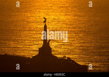 Aberystwyth Wales UK, Thursday 15 December 2016  UK weather:  The sun sets in a blaze of golden light over Cardigan - Stock Photo