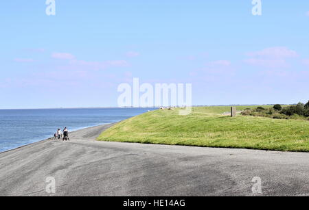 On top of a reinforced dike at the Wadden Sea coast near Lauwersoog, Friesland, Netherlands - Stock Photo