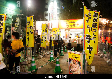 Japanese people and travelers foreigner standing queue buy ramen noodle japanese style at ramen festival at Shinjuku - Stock Photo