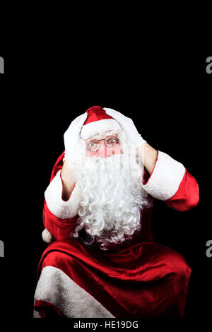 Santa Claus in the Christmas Night Isolated On Black Background - Stock Photo