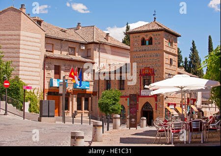 A cafe outside a church in the walled city of Toledo, Spain - Stock Photo