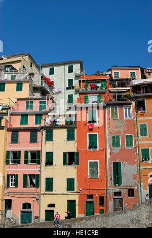 Colourful facades of houses in the village of Riomaggiore, Cinque Terre, Liguria, Italy, Europe - Stock Photo