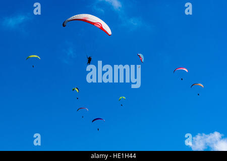 Many paragliders are flying over Pokhara and Phewa Lake - Stock Photo