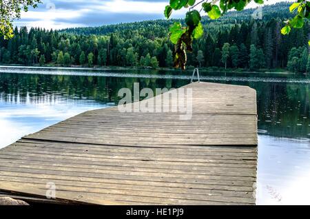 Jetty on Sognsvann Lake in Oslo Norway - Stock Photo