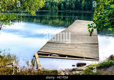A broken jetty on Sognsvann Lake - Stock Photo